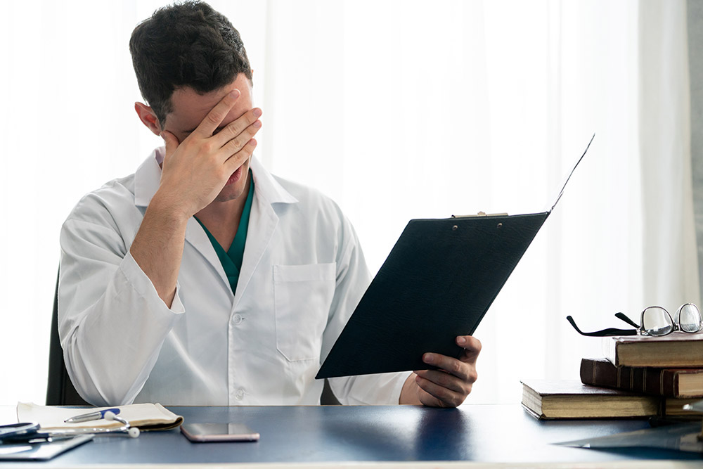 Doctor reviewing his medical mistake